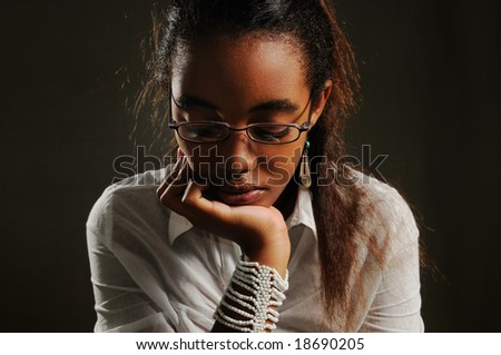 Portrait of teenage african woman with pensive expression - stock photo