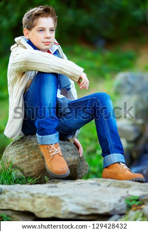 portrait of teenage boy, colorful outdoors - stock photo