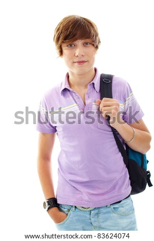 Portrait of teenage boy with backpack looking at camera - stock photo