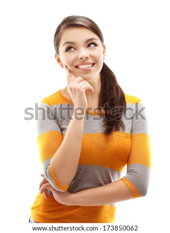 Portrait of  teenage girl looking up with hand on chin.White background. - stock photo