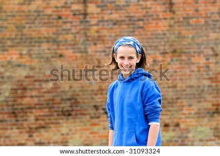 portrait of teenage girl smiling outdoors - stock photo