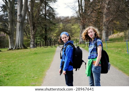 portrait of teenage girls going on a hike - stock photo