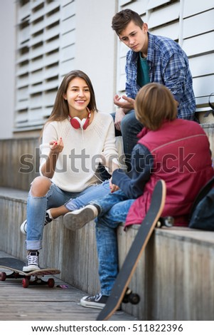Portrait of teenage males and girl 15-17 years old talking in autumn day