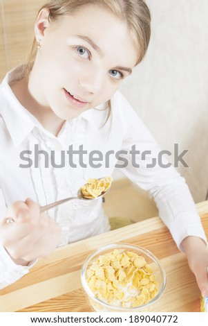 Portrait of Teenager Girl Eating Cereal Breakfast. Vertical Image - stock photo