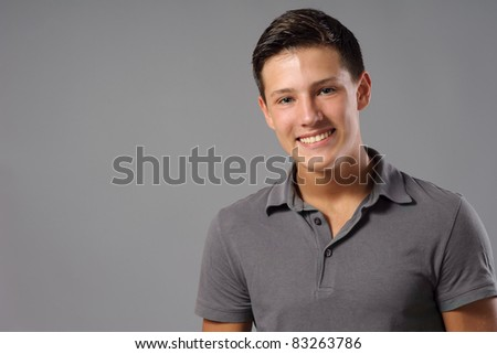 Portrait of teenager smiling at camera - stock photo