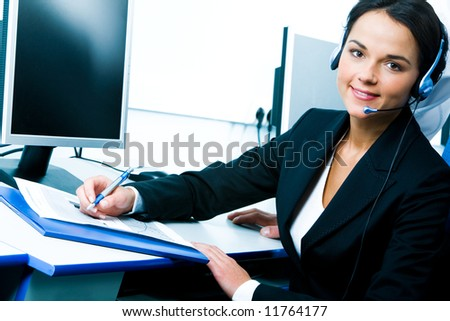 Portrait of telephone operator sitting at the table - stock photo