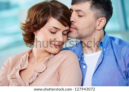 Portrait of tender couple enjoying being together