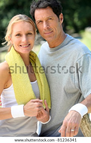 Portrait of tennis couple - stock photo