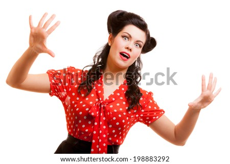 Portrait of terrified horrified young woman in red screaming shouting isolated. Girl with pinup makeup and hairstyle doing fun. Studio shot. Retro vintage style. Fear. - stock photo