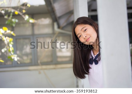 Portrait of thai student teen beautiful girl happy and relax in school - stock photo