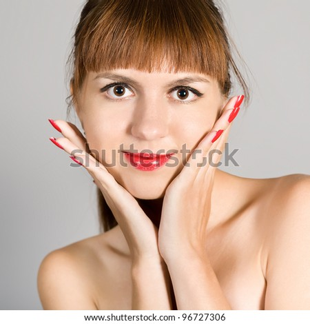 Portrait of the attractive girl on a gray background