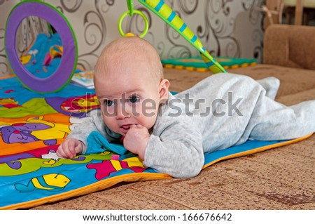 Portrait of the baby sucking a finger. - stock photo