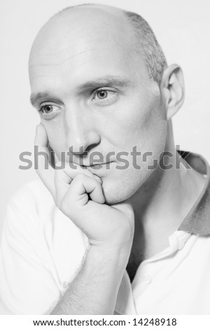 Portrait of the bald man. Thinking about something.