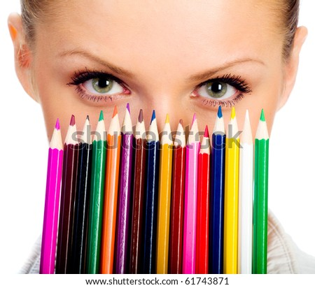 Portrait of the beatiful businesswomen with colorful pencil. - stock photo