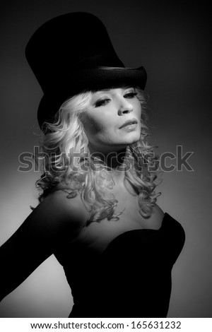 Portrait of the beautiful blonde in the cylinder. - stock photo
