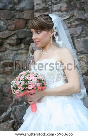 Portrait of the beautiful bride with a bouquet - stock photo