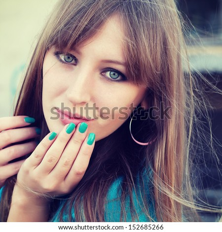 Portrait of the beautiful girl close-up, the wind fluttering hair - stock photo
