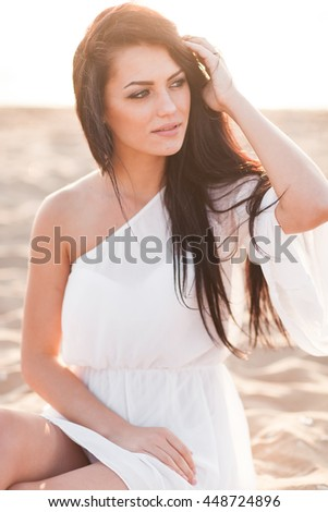 Portrait of the beautiful girl close-up, the wind fluttering hair. - stock photo