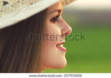 Portrait of the beautiful girl in the spring nature.  - stock photo