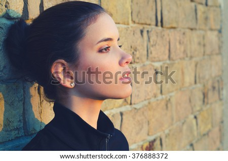 Portrait of the beautiful girl outdoor watching spring sunrise.  - stock photo