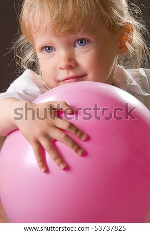 Portrait of the beautiful girl with a ball
