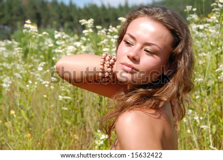 portrait of the beautiful girl with flowers