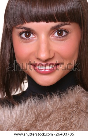 Portrait of the beautiful girl with magnificent fur, isolated on a white background