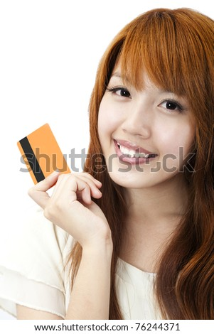 Portrait of the beautiful happy girl  holding  a credit card for shopping - stock photo