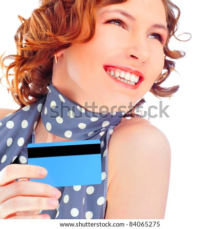 Portrait of the beautiful happy girl isolated on white background, holding in a hand a credit card - stock photo