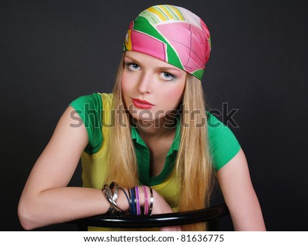 Portrait of the beautiful long-haired girl with a bright scarf on a head - stock photo