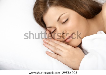Portrait of the beautiful sleeping woman in white bed - stock photo