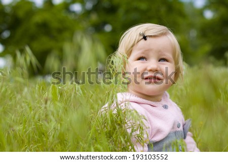 Portrait of the beautiful small child close up outdoor