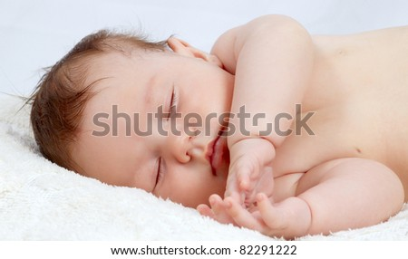 Portrait of the beautiful small sleeping baby
