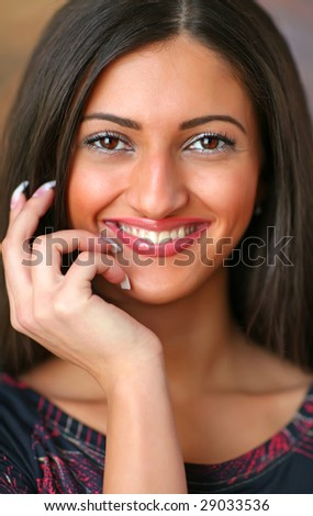 Portrait of the beautiful smiling woman with a white teeth