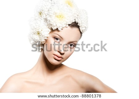 Portrait of the beautiful sweet woman with flowers - stock photo