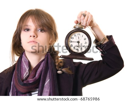 Portrait of the beautiful teenage girl with old alarm clock on a white background.