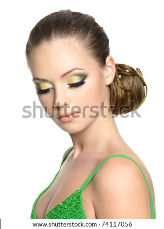 Portrait of the beautiful teenager girl with modern hairstyle looking down, isolated on whit - stock photo