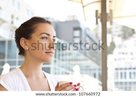 Portrait of the beautiful woman, drinking coffe in morning - stock photo