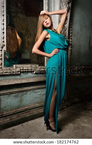portrait of the beautiful woman green gown.  Studio with interior of old palace. Not necessary property release. - stock photo