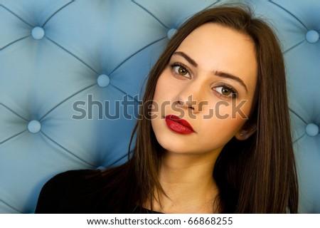 Portrait of the beautiful woman in black dress - stock photo