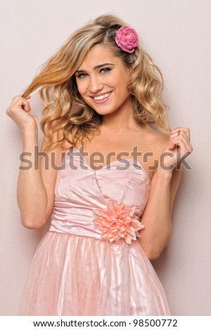 Portrait of the beautiful woman in chic dress. - stock photo