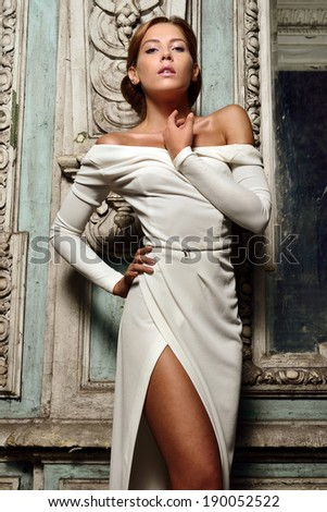 Portrait of the beautiful  woman in white dress. Studio with interior of old palace. Not necessary property release. - stock photo