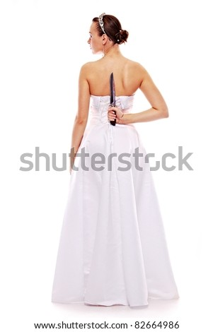 portrait of the beautiful woman in white gown with knife on white background - stock photo