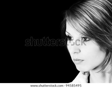 Portrait of the beautiful woman on a black background