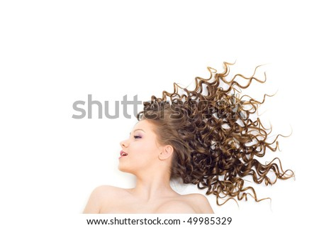 Portrait of the beautiful woman with long curly hair - stock photo