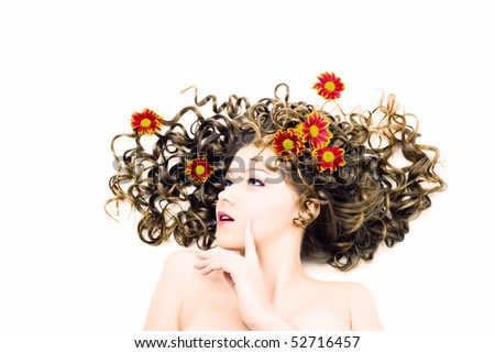 Portrait of the beautiful woman with long curly hair and flowers. Isolated - stock photo