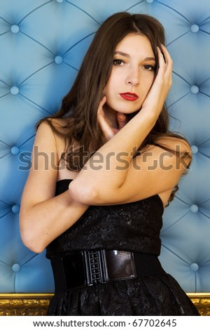 Portrait of the beautiful woman with naked shoulders - stock photo