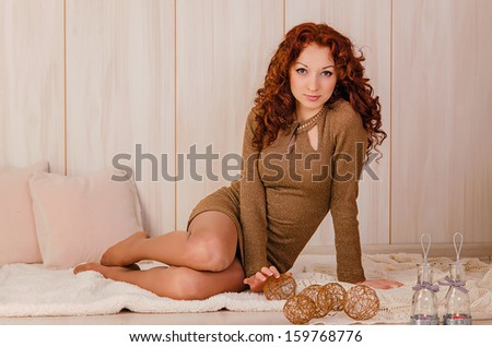 Portrait of the beautiful young red-haired girl in studio - stock photo