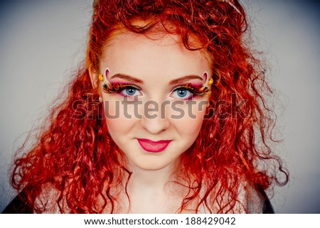 Portrait of the beautiful young red haired girl with gorgeous curly hair  - stock photo