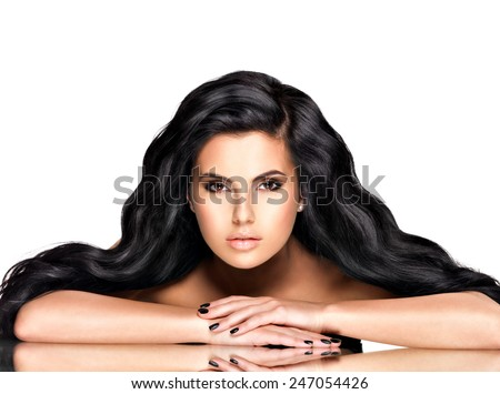 Portrait of the beautiful  young woman with black  hair - posing at studio - stock photo